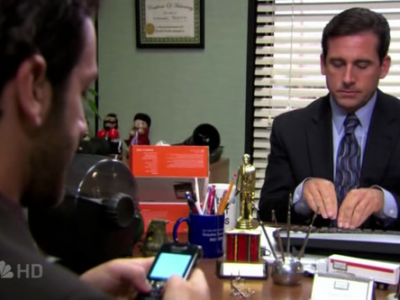 Michael Scott using a Blackberry
