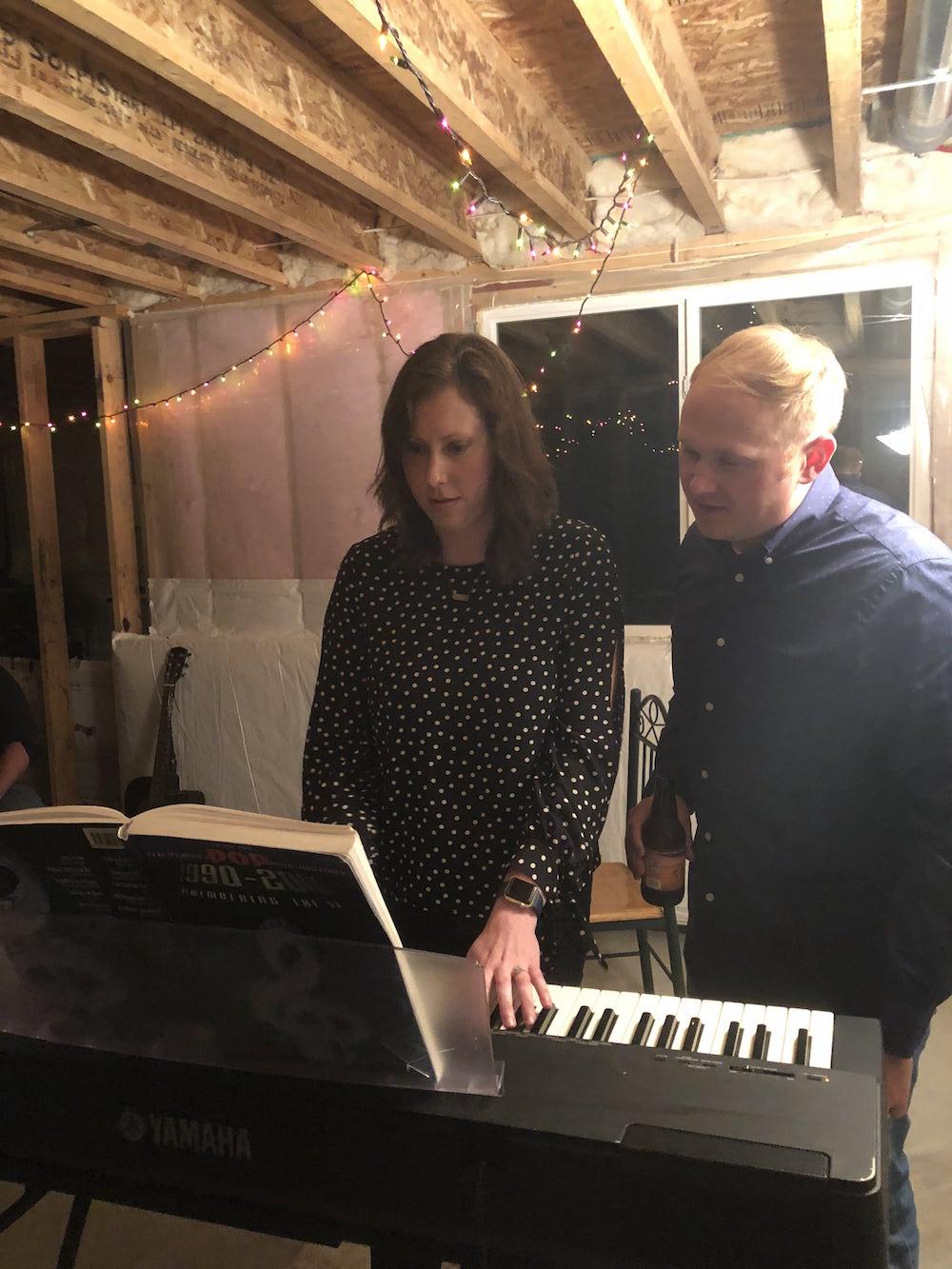 Bri and Josh playing piano and singing at the Rhinestone Theater